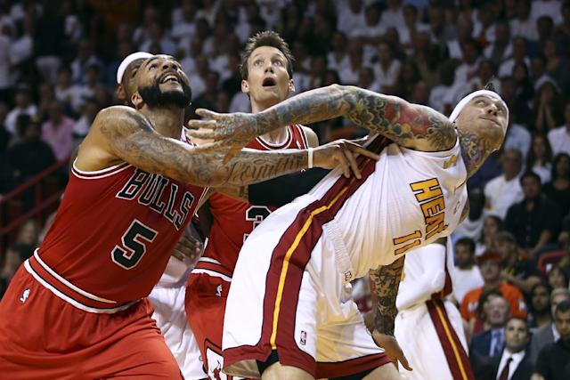 Chicago Bulls Carlos Boozer (5) and Mike Dunleavy battle for a rebound with the Miami Heat's Chris Andersen (11) during the first half of an NBA basketball game in Miami, Tuesday, Oct. 29, 2013. (AP Photo/J Pat Carter)