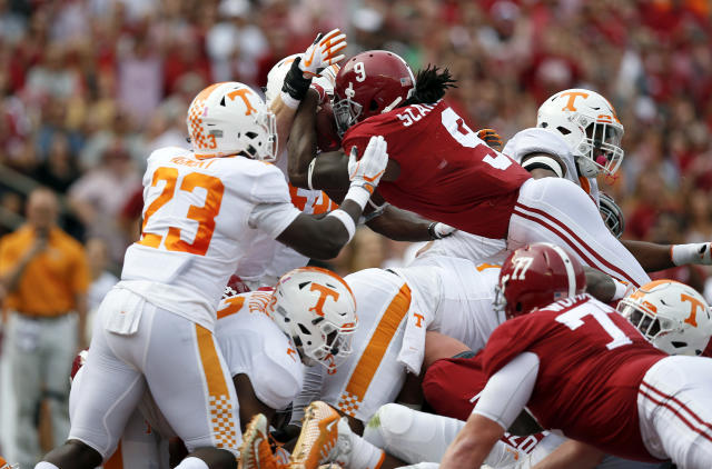 Alabama running back Bo Scarbrough leaps into the end zone to score a touchdown during the first half an NCAA college football game against Tennessee, Saturday, Oct. 21, 2017, in Tuscaloosa, Ala. (AP Photo/Brynn Anderson)
