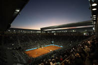 FILE - In this Saturday, May 11, 2019, file photo, Rafael Nadal, of Spain, and Stefanos Tsitsipas, of Greece, play the Madrid Open tennis men's semifinal match at the Caja Magica (Magic Box) in Madrid, Spain. With the sports calendar still mostly on hold because of the coronavirus pandemic, The Associated Press takes a look at some of the live sporting events that would have taken place the week of May 4-10, 2020, including the clay-court Madrid Open. (AP Photo/Bernat Armangue, File)