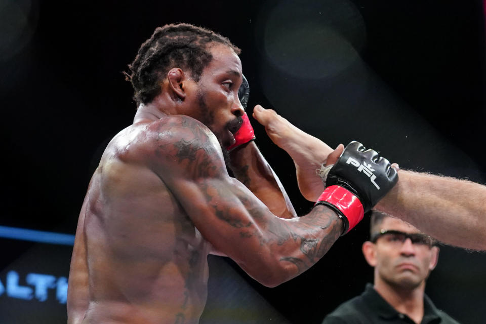 Bubba Jenkins blocks a kick from Bobby Moffett during a Professional Fighters League mixed martial arts bout in Atlantic City, N.J., Thursday, June 10, 2021. (AP Photo/Matt Rourke)