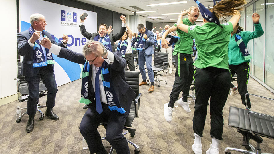 Australian officials and players, pictured here reacting after the World Cup announcement.