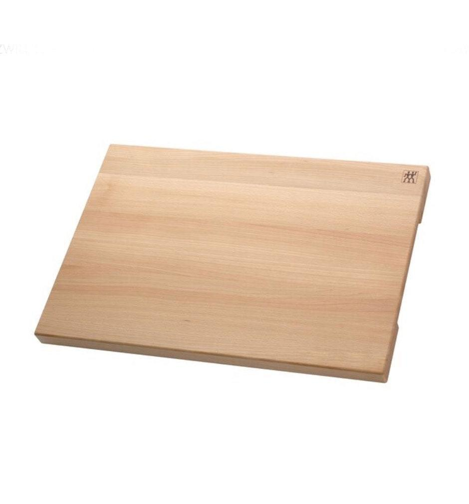 """""""A good butcher block cutting board is essential,"""" says Gerard. """"You'll use it daily; you can even just leave it out on your counter."""" $100, Zwilling. <a href=""""https://www.zwilling.com/us/zwilling-accessories-22x16x1.5-inch-natural-beechwood-cutting-board-35118-100/35118-100-0.html?cgid=cutlery_cutting-boards#start=1"""" rel=""""nofollow noopener"""" target=""""_blank"""" data-ylk=""""slk:Get it now!"""" class=""""link rapid-noclick-resp"""">Get it now!</a>"""