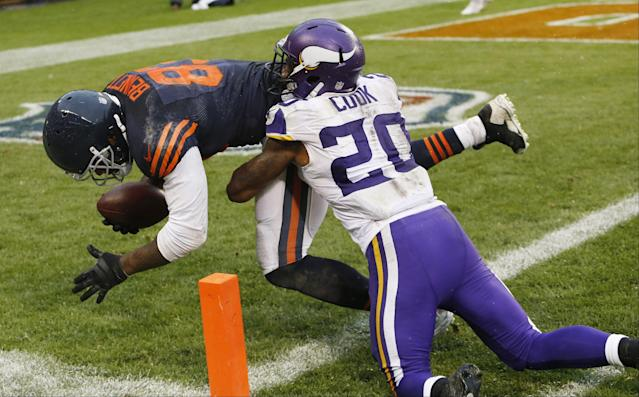 Chicago Bears tight end Martellus Bennett (83) crosses the goal line after a reception to score the game-winning touchdown late in the second half of an NFL football game on Sunday against the Minnesota Vikings, Sunday, Sept. 15, 2013, in Chicago. Vikings cornerback Chris Cook (20) defends. The Bears won 31-30. (AP Photo/Charles Rex Arbogast)