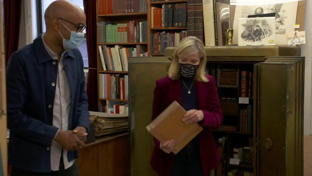 Nancy Bass Wyden, a third-generation owner of the Strand Book Store in New York City, pulls some precious editions from the store's safe for Kelefa Sanneh.  / Credit: CBS News