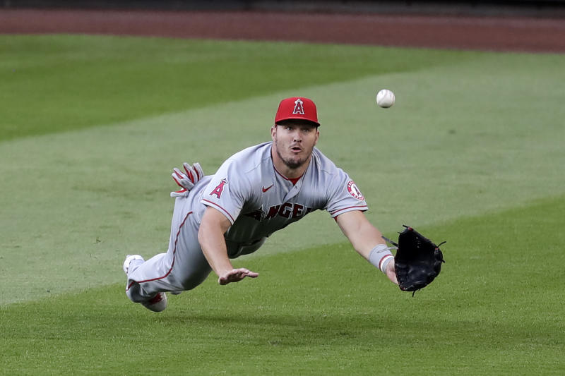 Los Angeles Angels center fielder Mike Trout dives for, but misses, a fly ball from Seattle Mariners' J.P. Crawford for a single in the third inning of a baseball game Wednesday, Aug. 5, 2020, in Seattle. (AP Photo/Elaine Thompson)