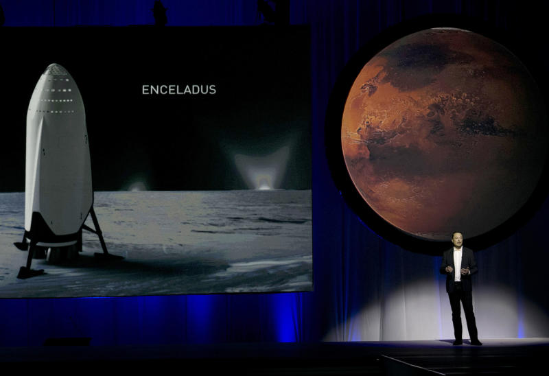 FILE - In this Tuesday, Sept. 27, 2016 file photo, SpaceX founder Elon Musk speaks during the 67th International Astronautical Congress in Guadalajara, Mexico. Starting with the dream of growing a rose on Mars, Musk's vision morphed into a shake-up of the old space industry, and a fleet of new private rockets. In 2020, thoserockets are scheduled to launch NASA astronautsfrom Florida to the International Space Station -- the first time a for-profit company will carry astronauts into the cosmos. (AP Photo/Refugio Ruiz)