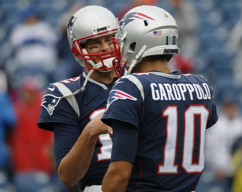 Tom Brady, pictured with Jimmy Garoppolo, is showing no signs that retirement is near. (AP)