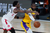 Los Angeles Lakers' LeBron James passes around Toronto Raptors' OG Anunoby (3) during the second half of an NBA basketball game Saturday, Aug. 1, 2020, in Lake Buena Vista, Fla. (AP Photo/Ashley Landis, Pool)