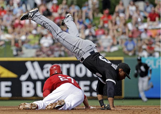 Los Angeles Angels' Mike Trout slides safely under Chicago White Sox's Micah Johnson as he steals second during the second inning of an exhibition spring training baseball game Thursday, March 13, 2014, in Tempe, Ariz. (AP Photo/Morry Gash)