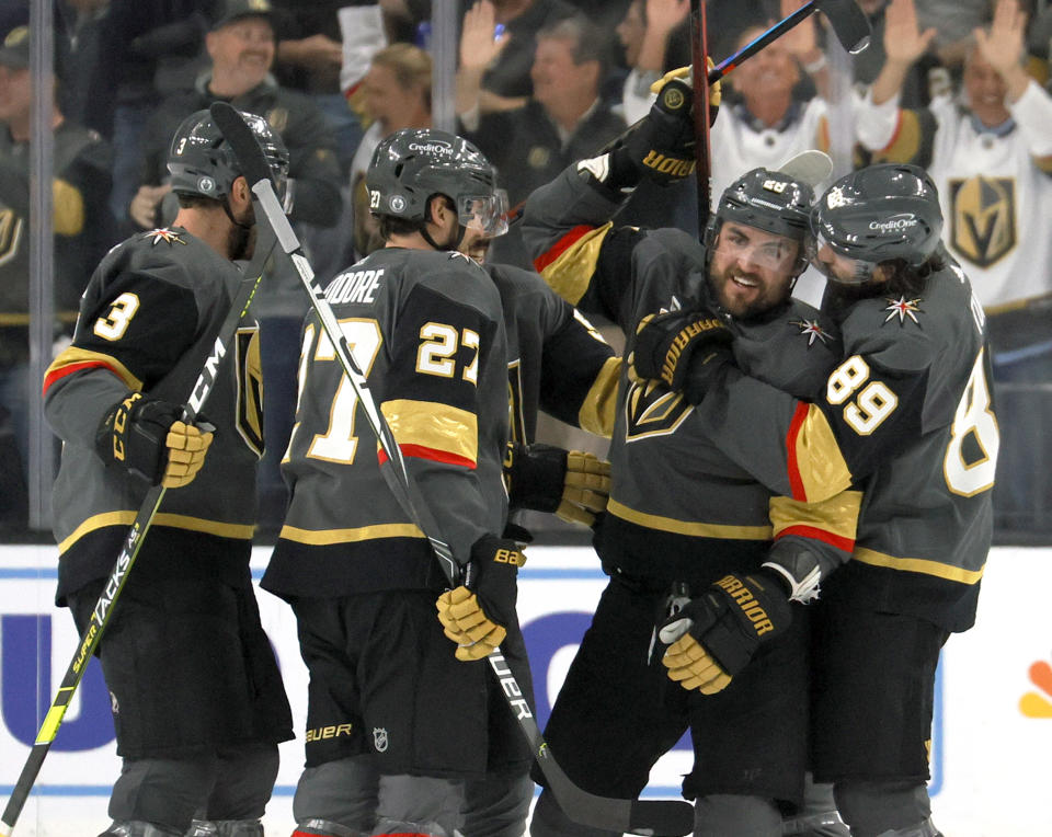 LAS VEGAS, NEVADA - JUNE 10:  The Vegas Golden Knights celebrate a third-period goal by William Carrier (2nd R) #28 against the Colorado Avalanche in Game Six of the Second Round of the 2021 Stanley Cup Playoffs at T-Mobile Arena on June 10, 2021 in Las Vegas, Nevada. The Golden Knights defeated the Avalanche 6-3 to win the series.  (Photo by Ethan Miller/Getty Images)