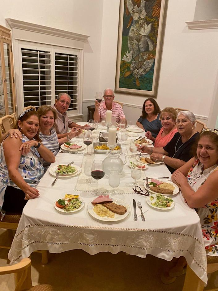 Elena Blasser (bottom left), 64, celebrates her first outing with her friends in a year after getting the COVID-19 vaccine. Blesser is among the 159 people still unaccounted for after a 12-story oceanside Miami condo plummeted early Thursday.