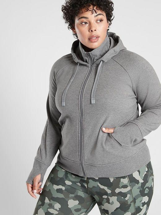 """<p><strong>Athleta</strong></p><p>athleta.gap.com</p><p><strong>$86.99</strong></p><p><a href=""""https://go.redirectingat.com?id=74968X1596630&url=https%3A%2F%2Fathleta.gap.com%2Fbrowse%2Fproduct.do%3Fpid%3D488379022%26vid%3D8%26tid%3Datpl000007%26kwid%3D1%26ap%3D7%26gclid%3DCj0KCQiAk53-BRD0ARIsAJuNhpt1qJzF86nMTc2FO_HkqEyGRzP3i6gRxWJJLmtIjZonvM9MfkgnPLIaAknjEALw_wcB%26gclsrc%3Daw.ds&sref=https%3A%2F%2Fwww.goodhousekeeping.com%2Fclothing%2Fg35139110%2Fbest-plus-size-workout-clothes%2F"""" rel=""""nofollow noopener"""" target=""""_blank"""" data-ylk=""""slk:Shop Now"""" class=""""link rapid-noclick-resp"""">Shop Now</a></p><p>Made with lightweight, stretchy cotton, <strong>the brand says this hoodie is breathable and good for medium and high-impact workouts</strong>. It features two front pockets, thumbholes, and a ribbed cuff collar for a warmer fit. </p>"""