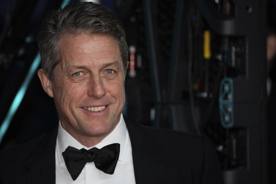 Hugh Grant poses for photographers upon arrival at the Bafta Film Awards, in central London, Sunday, Feb. 2 2020. (Photo by Vianney Le Caer/Invision/AP)