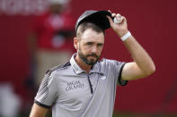 Troy Merritt acknowledges the crowd after finishing the third round of the Rocket Mortgage Classic golf tournament, Saturday, July 3, 2021, at the Detroit Golf Club in Detroit. (AP Photo/Carlos Osorio)