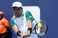 Roberto Bautista Agut of Spain returns to Jannik Sinner of Italy during the semifinals of the Miami Open tennis tournament, Friday, April 2, 2021, in Miami Gardens, Fla. (AP Photo/Lynne Sladky)