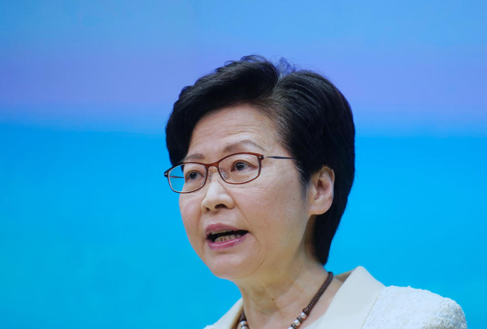Hong Kong Chief Executive Carrie Lam speaks during a news conference in Hong Kong, Tuesday, May 11, 2021. Lam announced Hong Kong officials have dropped a plan to make it mandatory for foreign domestic workers to be vaccinated against the coronavirus, after the move drew criticism that it was discriminatory. (AP Photo/Vincent Yu)