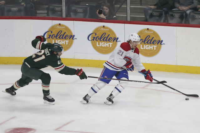 Montreal Canadiens' Nick Cousins controls the puck against Minnesota Wild's Carson Soucy in the first period of an NHL hockey game Sunday Oct. 20, 2019, in St. Paul, Minn. (AP Photo/Stacy Bengs)