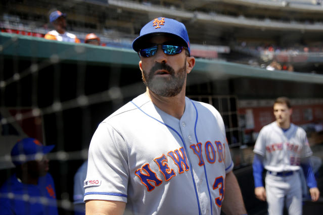 New York Mets manager Mickey Callaway stands in the dugout before a baseball game against the Washington Nationals, Thursday, May 16, 2019, in Washington. (AP Photo/Patrick Semansky)