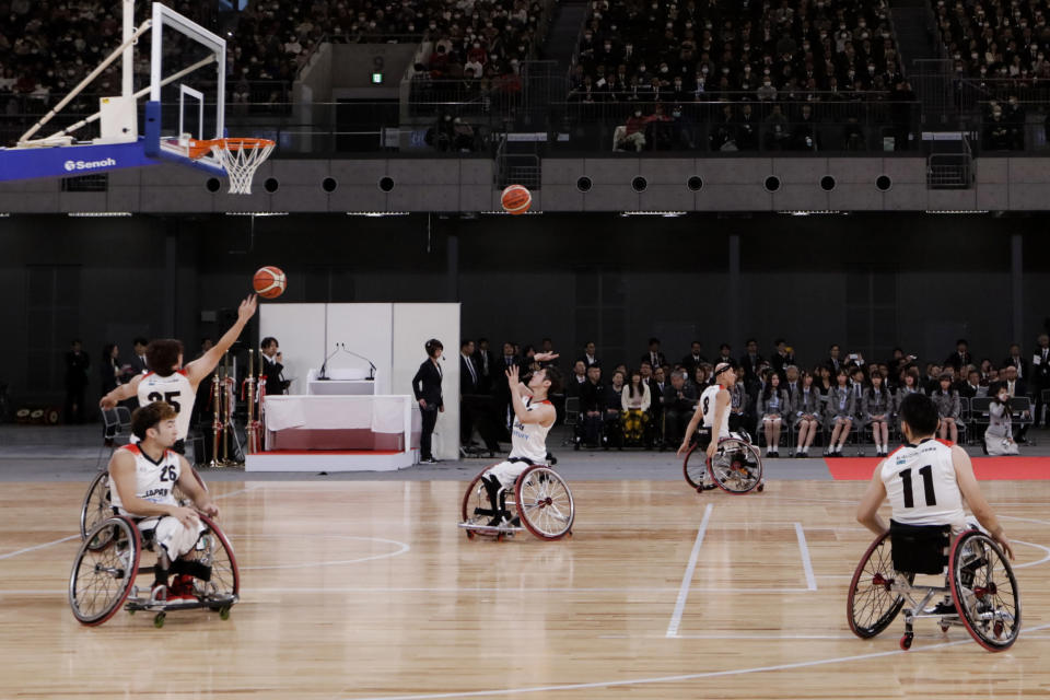 FILE - In this Feb. 2, 2020, file photo, members of Japan's national wheelchair basketball team warm up on the court during a grand opening ceremony of the Ariake Arena, a venue for volleyball at the Tokyo 2020 Olympics and wheelchair basketball during the Paralympic Games, in Tokyo. The opening next week of the Paralympic Games in Tokyo is being used as a stage to launch a human rights movement aimed at the world's 1.2 billion people with disabilities.(AP Photo/Jae C. Hong, File)