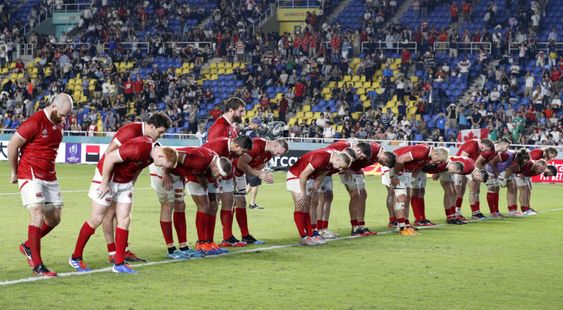 Canada's players bow to the spectators after their loss to Italy during the Rugby World Cup Pool B match in Fukuoka, western Japan, Thursday, Sept. 26, 2019. (Miyuki Saito/Kyodo News via AP)