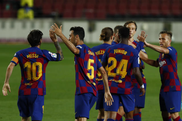 Barcelona's players celebrate Ansu Fati's goal during the Spanish La Liga soccer match between FC Barcelona and Leganes at the Camp Nou stadium in Barcelona, Spain, Tuesday, June 16, 2020. (AP Photo/Joan Montfort)