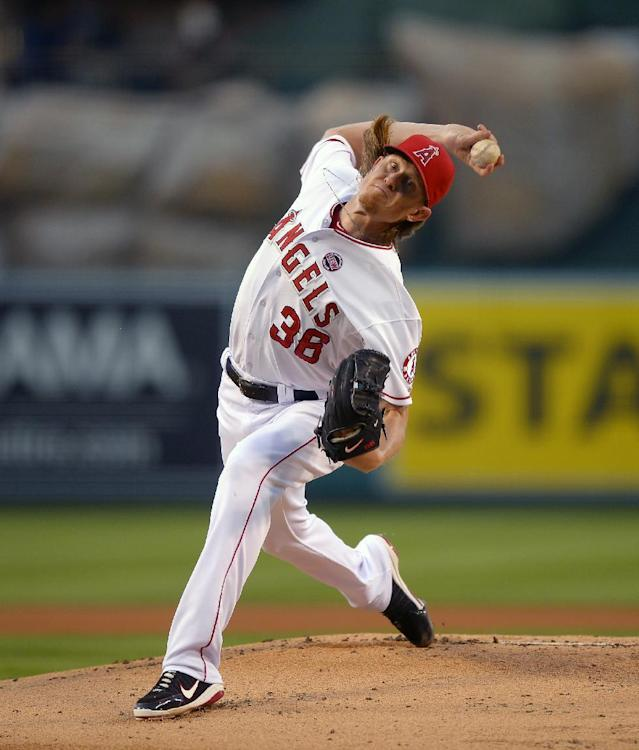 Los Angeles Angels starting pitcher Jered Weaver throws to the plate during the first inning of their baseball game against the Cleveland Indians, Monday, Aug. 19, 2013, in Anaheim, Calif. (AP Photo/Mark J. Terrill)