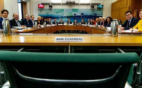 "This photo posed for the photographer on Tuesday Nov. 27, 2018 and made available by the House of Commons shows the International Grand Committee with representation from 9 Parliaments and Mark Zuckerberg in non-attendance. Lawmakers from nine countries grilled Facebook executive, Richard Allan, on Tuesday as part of an international hearing at Britain's parliament on disinformation and ""fake news."" Facebook's vice president for policy solutions, answered questions in place of his boss, CEO Mark Zuckerberg, who ignored repeated requests to appear - Credit: Gabriel Sainhas/House of Commons/AP"