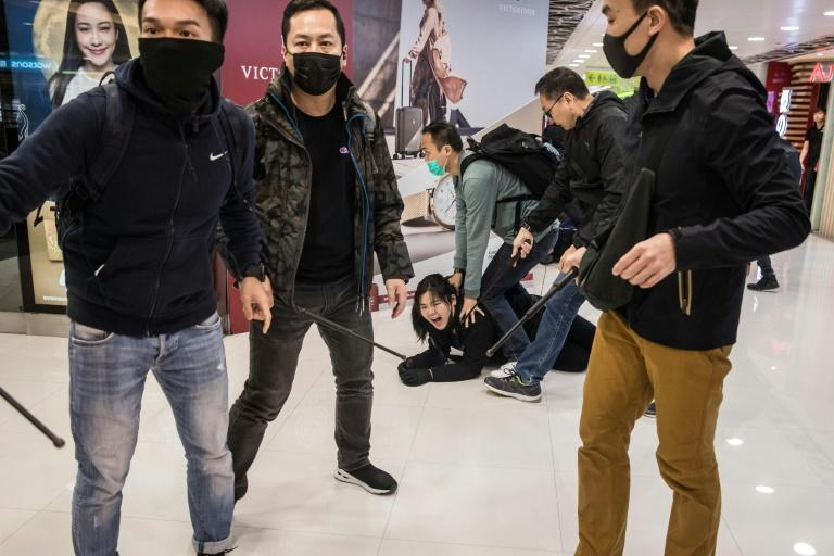Plainclothes police detain a protester in Sheung Shui. The protests were initially sparked by an extradition bill but have since morphed into a popular revolt against Beijing's rule (AFP Photo/DALE DE LA REY)
