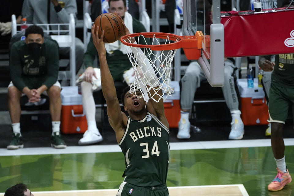 Milwaukee Bucks forward Giannis Antetokounmpo (34) dunks against the Phoenix Suns during the second half of Game 3 of basketball's NBA Finals in Milwaukee, Sunday, July 11, 2021. (AP Photo/Paul Sancya)