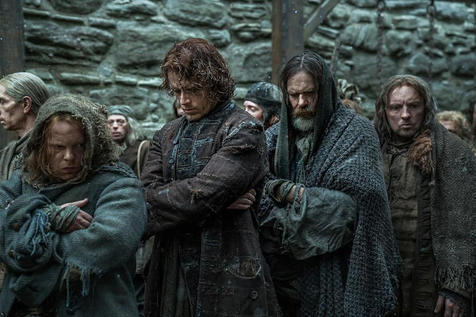 James Allenby Kirk as Hayes, Sam Heughan as Jamie Fraser, Duncan Lacroix as Murtagh Fitzgibbons, and Keith Fleming as Lesley in <i>Outlander</i>. (Photo: Starz)