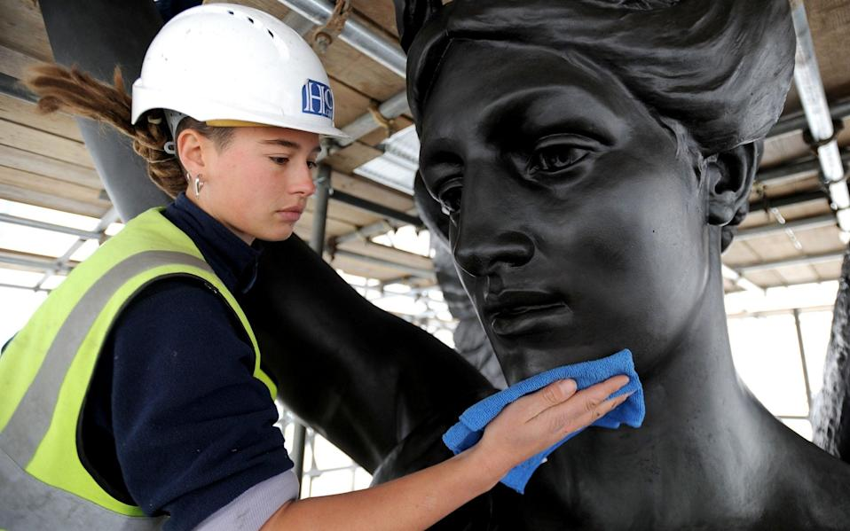 Buffing Adrian Jones's sculpture of Peace on the Wellington Arch Quadriga in London - Nick Ansell/PA Archive