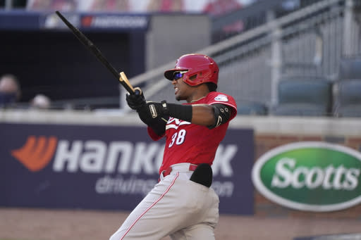 Cincinnati Reds shortstop Jose Garcia (38) breaks his bat as he grounds out against the Atlanta Braves in the 13th inning during Game 1 of a National League wild-card baseball series, Wednesday, Sept. 30, 2020, in Atlanta. (AP Photo/John Bazemore)