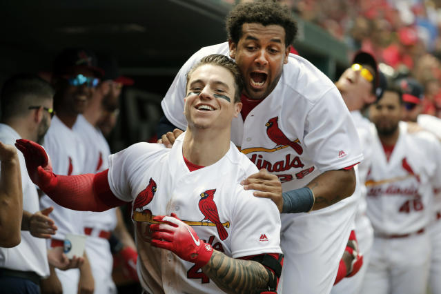 St. Louis Cardinals' Tyler O'Neill, left, is congratulated by teammate Jose Martinez after hitting a solo home run during the sixth inning of a baseball game against the Philadelphia Phillies, Sunday, May 20, 2018, in St. Louis. (AP Photo/Jeff Roberson)