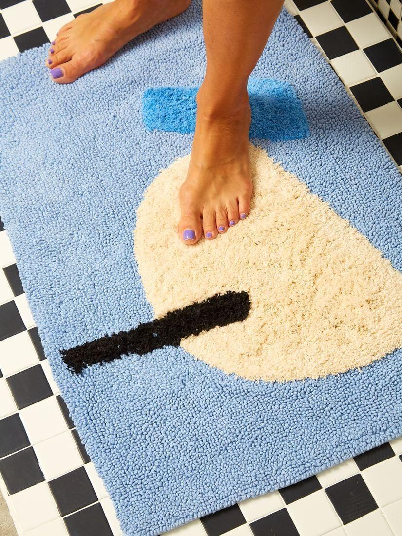 <p>Upgrade your bathroom with this <span>Cold Picnic Cool Breeze Bath Mat</span> ($60).</p>