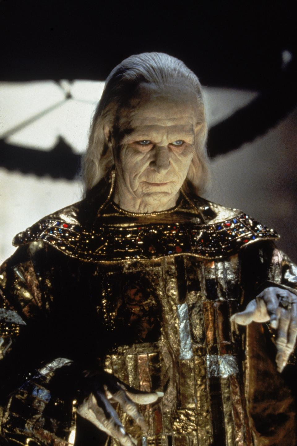British actor Gary Oldman, very heavily made up and dressed in a metallic. jewel-encrusted cape, gestures menacingly in a scene from the film 'Bram Stoker's Dracula,' directed by Francis Ford Coppola, California, 1992. (Photo by Columbia Pictures/Fotos International/Getty Images)