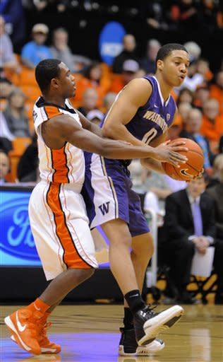 Washington's Abdul Gaddy (0) drives against Oregon State's Ahmad Starks (3) during the first half of an NCAA college basketball game in Corvallis, Ore., Wednesday Jan. 23, 2013. (AP Photo/Greg Wahl-Stephens)