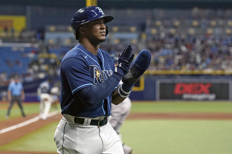 Tampa Bay Rays' Wander Franco reacts after scoring on a two-run single by Francisco Mejia off Boston Red Sox starting pitcher Eduardo Rodriguez during the first inning of a baseball game Tuesday, June 22, 2021, in St. Petersburg, Fla. (AP Photo/Chris O'Meara)