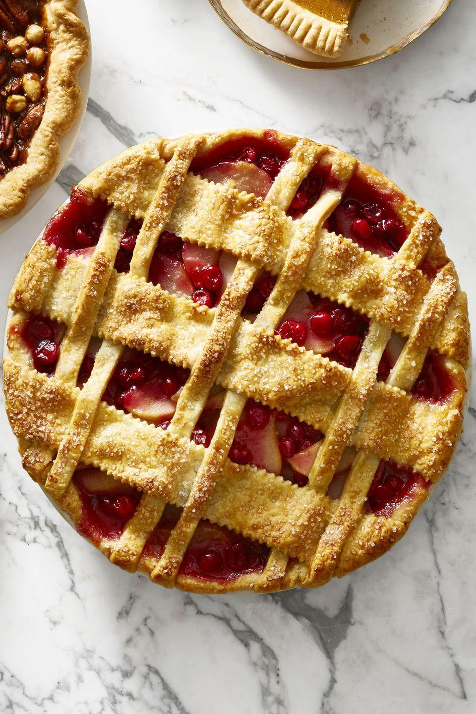 "<p><a href=""https://www.goodhousekeeping.com/holidays/thanksgiving-ideas/g112/cranberry-sauce-recipes/"" rel=""nofollow noopener"" target=""_blank"" data-ylk=""slk:Cranberry sauce"" class=""link rapid-noclick-resp"">Cranberry sauce</a> for dinner and cranberry pie for dessert — now that's one way to get your daily dose of fruit.</p><p><em><a href=""https://www.goodhousekeeping.com/food-recipes/dessert/a46629/cranberry-pear-lattice-pie-recipe/"" rel=""nofollow noopener"" target=""_blank"" data-ylk=""slk:Get the recipe for Cranberry-Pear Lattice Pie »"" class=""link rapid-noclick-resp"">Get the recipe for Cranberry-Pear Lattice Pie »</a></em></p><p><strong>RELATED: </strong><a href=""https://www.goodhousekeeping.com/food-recipes/dessert/a23899901/how-to-make-pie-crust/"" rel=""nofollow noopener"" target=""_blank"" data-ylk=""slk:How to Make Perfectly Flaky Pie Crust"" class=""link rapid-noclick-resp"">How to Make Perfectly Flaky Pie Crust</a></p>"