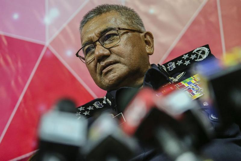 IGP Tan Sri Mohamad Fuzi Harun says a man is being investigated for posting an insulting comment on the Hindu religion on social media. ― Picture by Hari Anggara