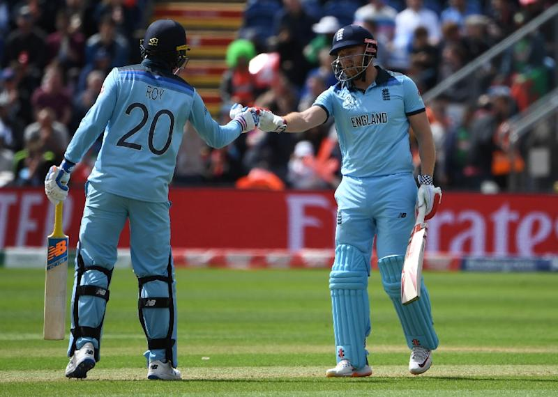 England's Jason Roy (left) and Jonny Bairstow celebrate reaching their 50 partnership in the World Cup match against Bangladesh