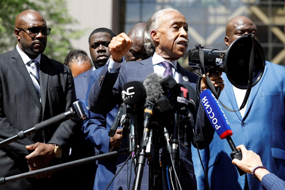 Reverend Al Sharpton, surrounded by relatives of George Floyd, speaks outside court (REUTERS)