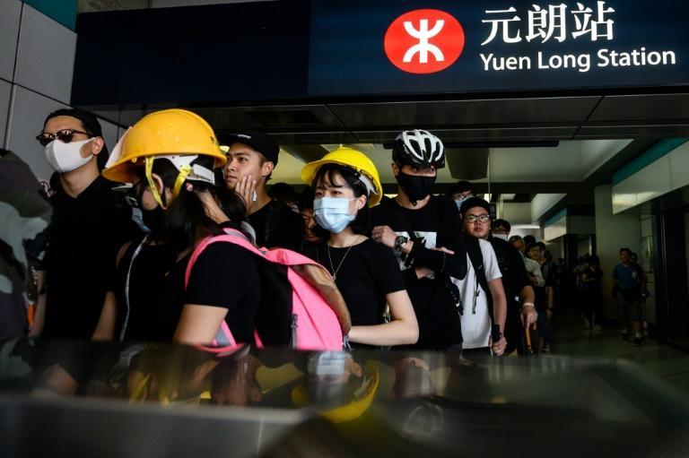 Hong Kong's MTR is the latest company to feel the heat from Beijing's hardening rhetoric over anti-government protests (AFP Photo/Philip FONG)