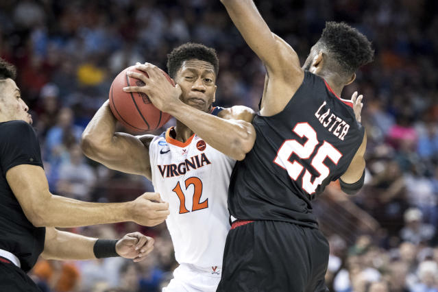 Virginia guard De'Andre Hunter (12) drives to the hoop against Gardner-Webb forward DJ Laster (25) during a first-round game in the NCAA men's college basketball tournament Friday, March 22, 2019, in Columbia, S.C. (AP Photo/Sean Rayford)