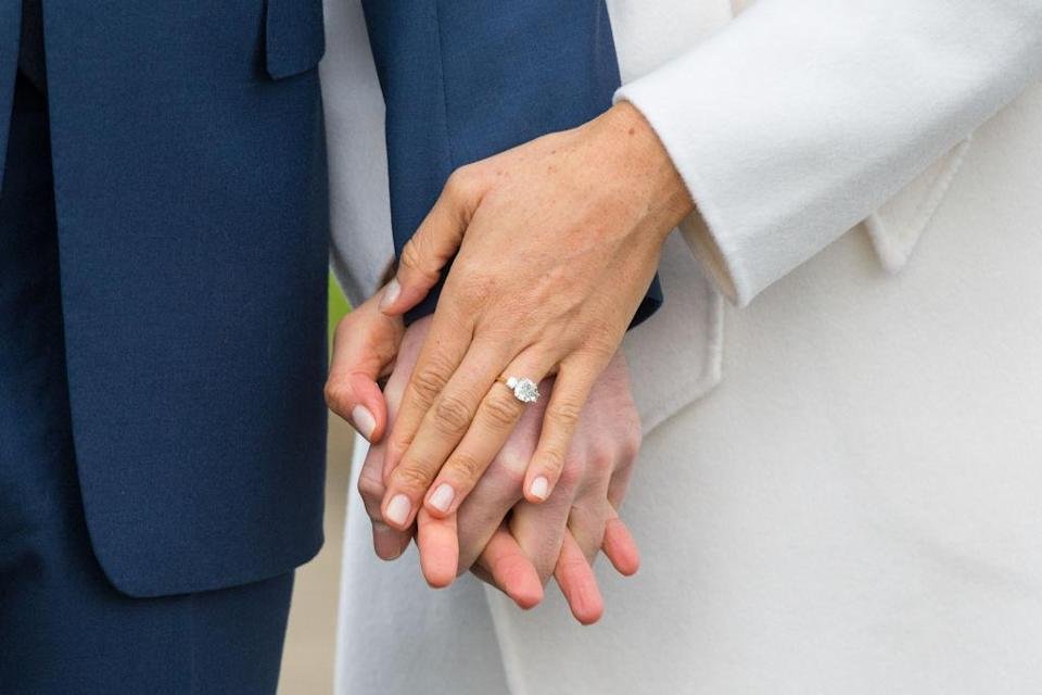 Markle's beautiful ring stands out from her naturally groomed nails. (Photo: Getty Images)