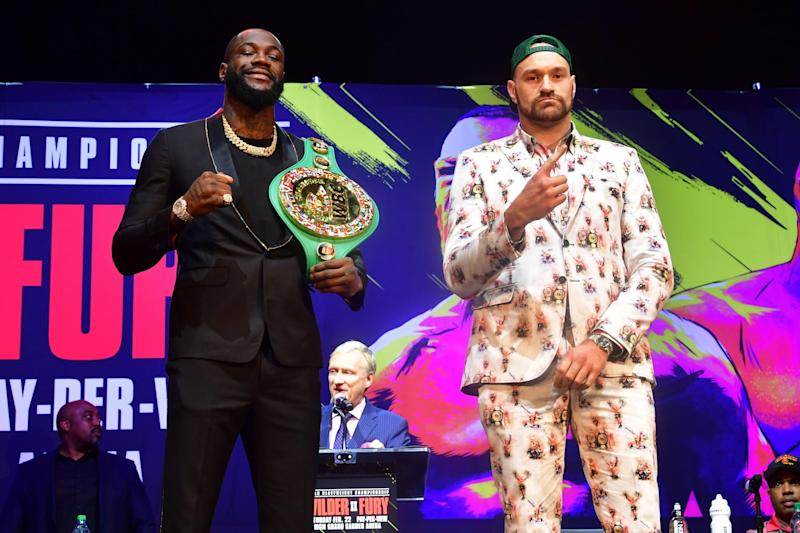 Boxers Deontay Wilder (L) and Tyson Fury (R) gesture on arrival for a press conference in Los Angeles, California on January 13, 2020 ahead of their re-match fight in Las Vegas on February 22. (Photo by Frederic J. BROWN / AFP) (Photo by FREDERIC J. BROWN/AFP via Getty Images)