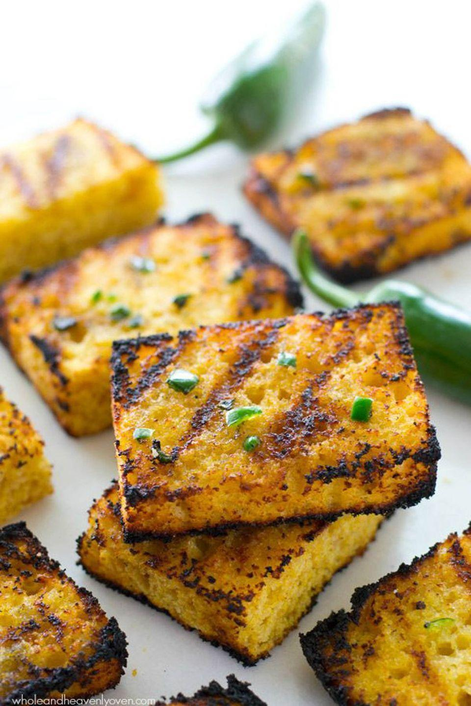 """<p>Grilled cornbread is our new favorite thing.</p><p><strong>Get the recipe at <a href=""""http://wholeandheavenlyoven.com/2015/07/20/grilled-cornbread-with-jalapeno-honey-butter/"""" rel=""""nofollow noopener"""" target=""""_blank"""" data-ylk=""""slk:Whole and Heavenly Oven"""" class=""""link rapid-noclick-resp"""">Whole and Heavenly Oven</a>.</strong> </p><p><strong><a class=""""link rapid-noclick-resp"""" href=""""https://go.redirectingat.com?id=74968X1596630&url=https%3A%2F%2Fwww.walmart.com%2Fip%2FThe-Pioneer-Woman-Timeless-Beauty-Pre-Seasoned-Plus-20-Cast-Iron-Double-Griddle%2F117723541&sref=https%3A%2F%2Fwww.thepioneerwoman.com%2Ffood-cooking%2Fmeals-menus%2Fg32188535%2Fbest-grilling-recipes%2F"""" rel=""""nofollow noopener"""" target=""""_blank"""" data-ylk=""""slk:SHOP GRIDDLES"""">SHOP GRIDDLES </a></strong></p>"""