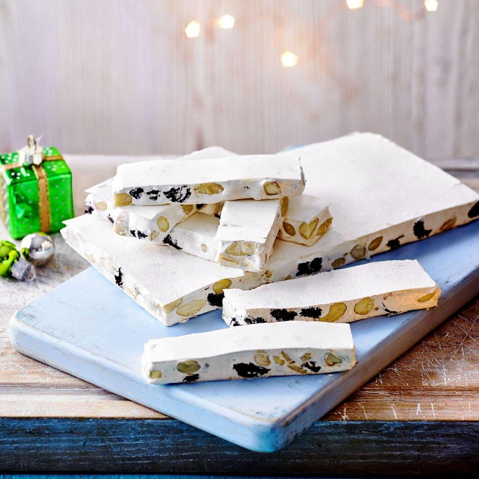 """<p>If you can't get hold of rice/wafer paper, line your tin with baking parchment and dust generously with cornflour. Top the nougat with an even dusting of cornflour and lay on a square of baking parchment before setting. </p><p><strong>Recipe: <a href=""""https://www.goodhousekeeping.com/uk/christmas/christmas-recipes/a34770988/honey-cherry-almond-nougat/"""" rel=""""nofollow noopener"""" target=""""_blank"""" data-ylk=""""slk:Honey, Cherry & Almond Nougat"""" class=""""link rapid-noclick-resp"""">Honey, Cherry & Almond Nougat</a></strong></p>"""