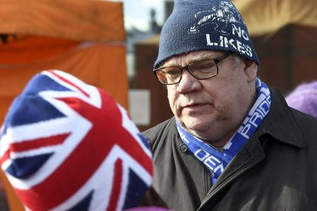 Finnish Foreign Minister Timo Soini is seen after an attempted attack at the Korson Maalaismarkkinat country fair in Vantaa, Finland March 24, 2019.  Lehtikuva/Heikki Saukkomaa via REUTERS  ATTENTION EDITORS - THIS IMAGE WAS PROVIDED BY A THIRD PARTY. NO THIRD PARTY SALES. NOT FOR USE BY REUTERS THIRD PARTY DISTRIBUTORS. FINLAND OUT. NO COMMERCIAL OR EDITORIAL SALES IN FINLAND.