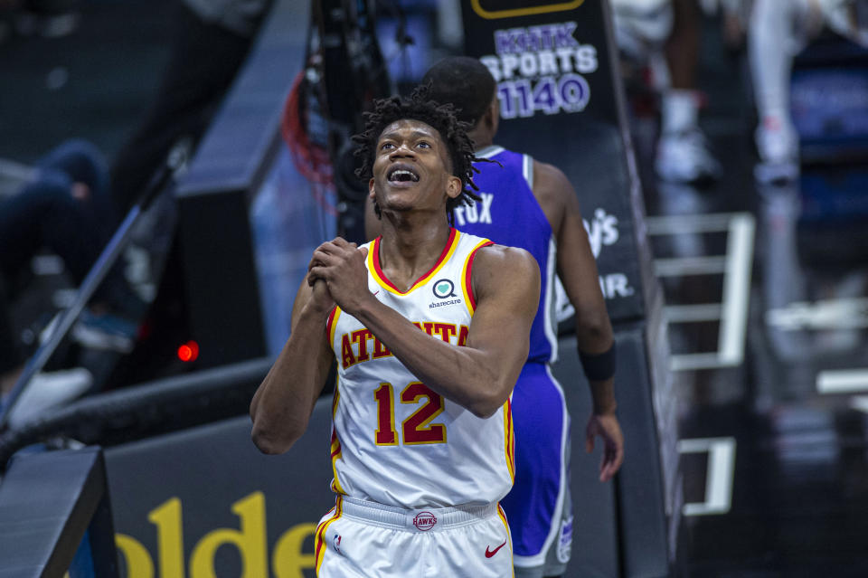 Atlanta Hawks forward De'Andre Hunter (12) reacts to a foul call during the fourth quarter of the team's NBA basketball game against the Sacramento Kings in Sacramento, Calif., Wednesday, March 24, 2021. (AP Photo/Hector Amezcua)