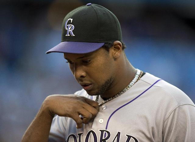 Colorado Rockies starting pitcher Juan Nicasio walks off the field after the third inning of a baseball game against the Toronto Blue Jays in Toronto on Wednesday, June 19, 2013. (AP Photo/The Canadian Press, Frank Gunn)